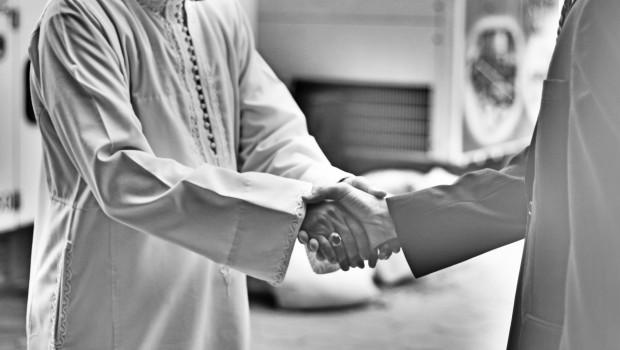 muslim shaking hands