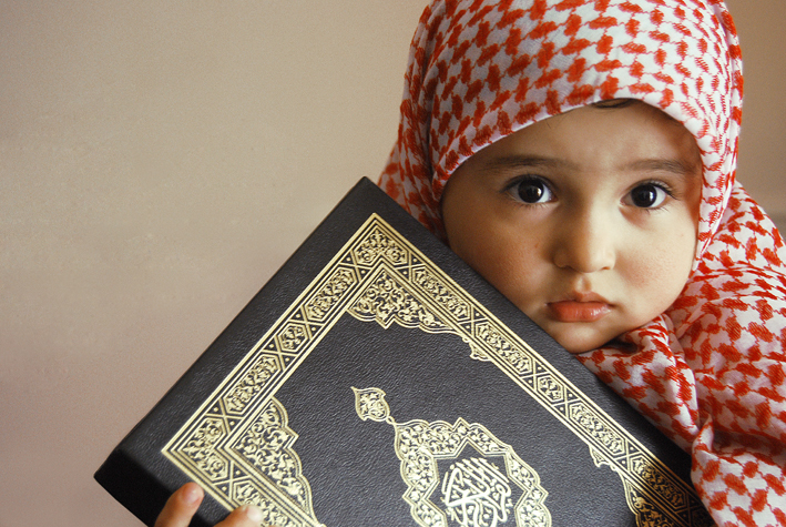 cute little muslim baby holing holy quran 1 eaalim institute