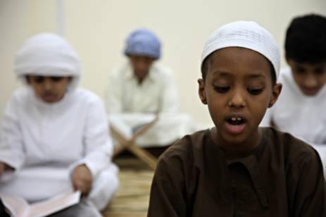 boy reciting quran