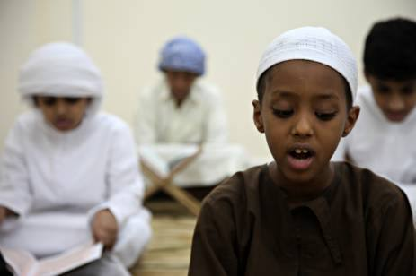 boy read quran