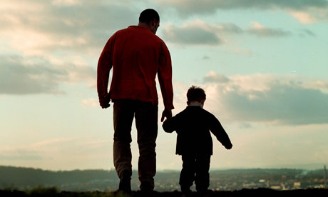 a father and son walking